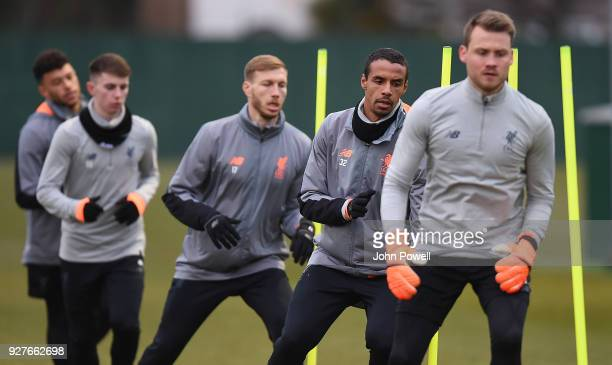 Joel Matip Ragnar Klavan and Ben Woodburn of Liverpool during a training session at Melwood Training Ground on March 5 2018 in Liverpool England