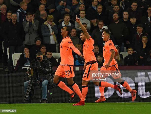 Joel Matip Scores the second and celebrates for Liverpool during the Premier League match between West Ham United and Liverpool at London Stadium on...