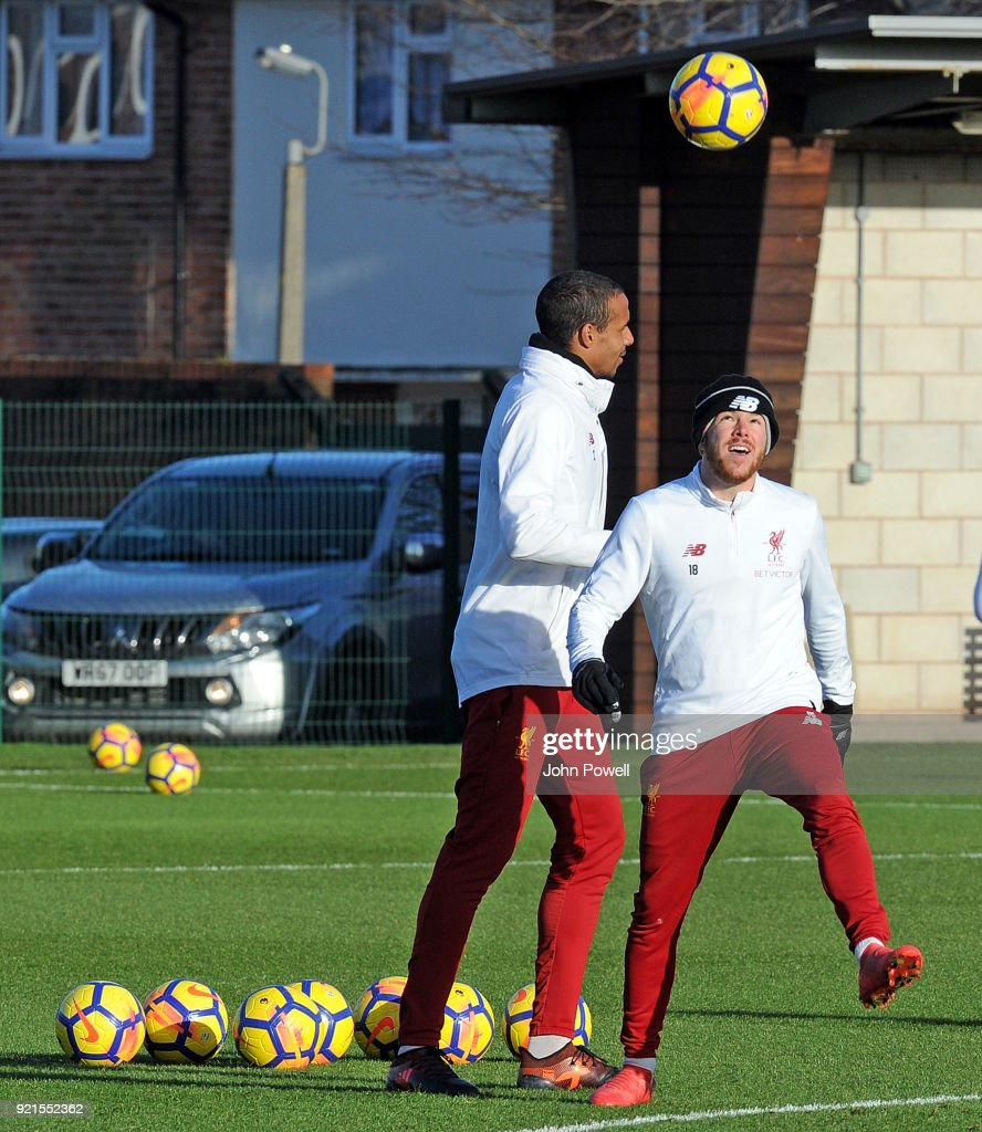 Joel Matip with Alberto Moreno of Liverpool during a training session at Melwood Training Ground on February 20, 2018 in Liverpool, England.