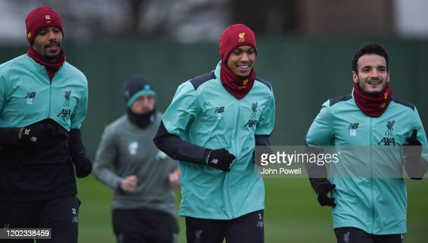 Joel Matip with Fabinho and Pedro Chirivella of Liverpool during a training session at Melwood Training Ground on January 27, 2020 in Liverpool,...