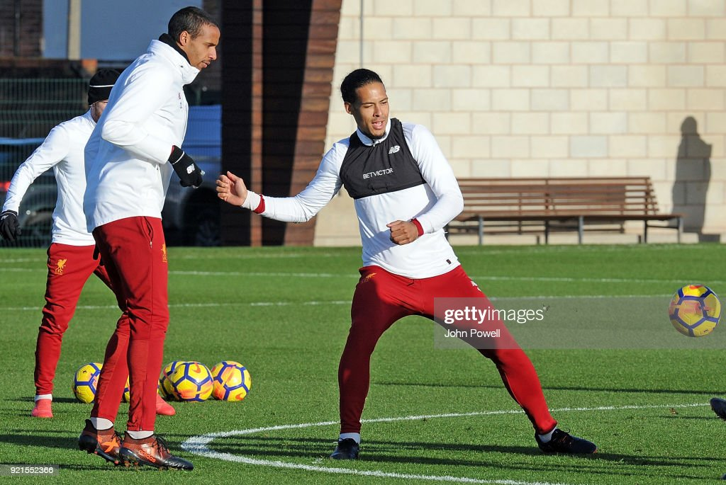 Joel Matip with Virgil van Dijk of Liverpool during a training session at Melwood Training Ground on February 20, 2018 in Liverpool, England.