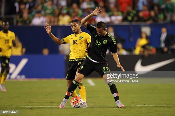 Joel McAnuff of Jamaica and Paul Aguilar of Mexico during the 2015 CONCACAF Gold Cup Final match between Jamaica and Mexico at Lincoln Financial...