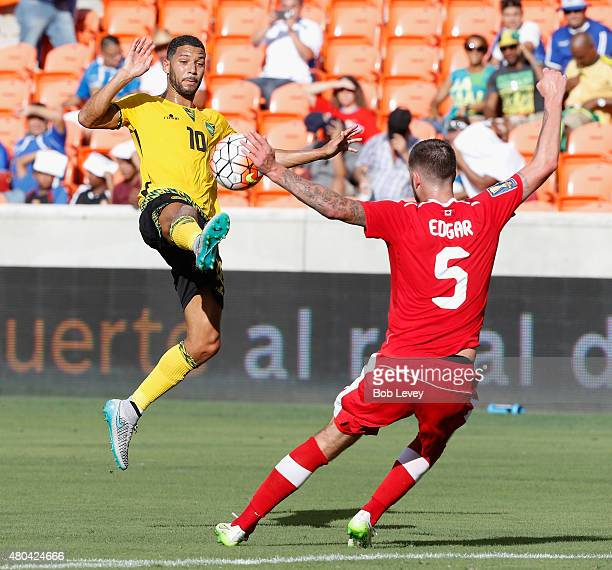 Joel McAnuff of Jamaica attempts to gain possession of the ball in front of David Edgar of Canada in the first half at BBVA Compass Stadium on July...
