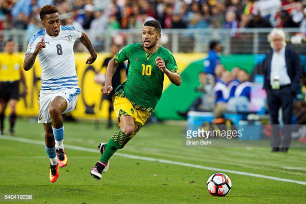 Joel McAnuff of Jamaica streaks up the sideline against Abel Hernandez of Uruguay during a group C match at Levi's Stadium as part of Copa America...