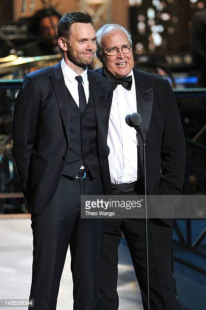 Joel McHale and actor Chevy Chase speak onstage at The Comedy Awards 2012 at Hammerstein Ballroom on April 28 2012 in New York City