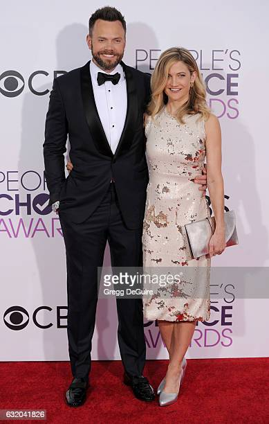 Joel McHale and Sarah Williams arrive at the 2017 People's Choice Awards at Microsoft Theater on January 18 2017 in Los Angeles California