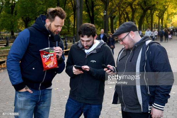 Joel McHale speaks with participants Michael Carolan and Steven Asarch while hosting Mtn Dew Doritos and Xbox Drop Zone the first of this weekend's...