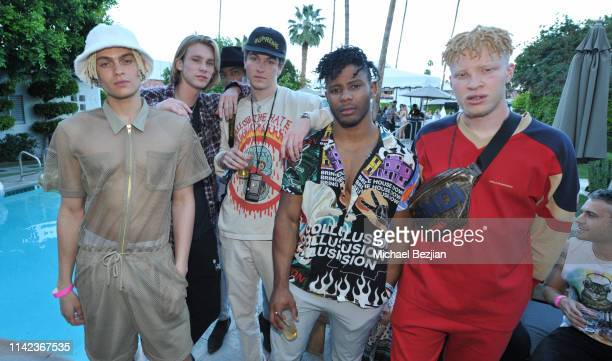 Joel Mignott and Shaun Ross pose for portrait with guests at beGlammed Sunset Soiree Presented by Fullscreen on April 12 2019 in Palm Springs...