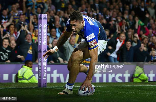 Joel Moon of the Leeds Rhinos breaks away to score his teams second try during the First Utility Super League Grand Final between Wigan Warriors and...