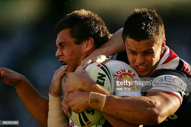 Joel Moon of the Warriors is tackled by Sandor Earl of the Roosters during the round 19 NRL match between the Sydney Roosters and the Warriors at the...