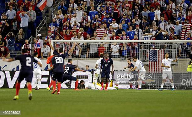 Joel Nathaniel Campbell of Costa Rica reacts after scoring a goal on Tim Howard of the United States during the second half at Red Bull Arena on...