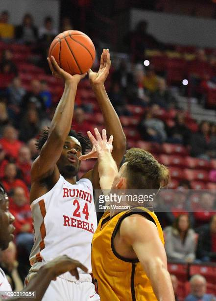 Joel Ntambwe of the UNLV Rebels shoots against Hunter Thompson of the Wyoming Cowboys during their game at the Thomas Mack Center on January 05 2019...