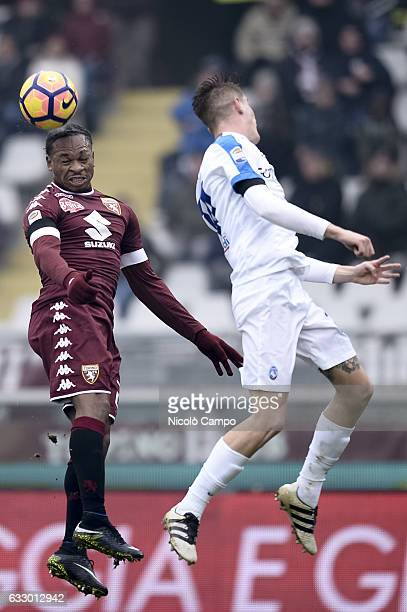 Joel Obi of Torino FC and Andrea Conti of Atalanta BC compete for a header during the Serie A football match between Torino FC and Atalanta BC Final...