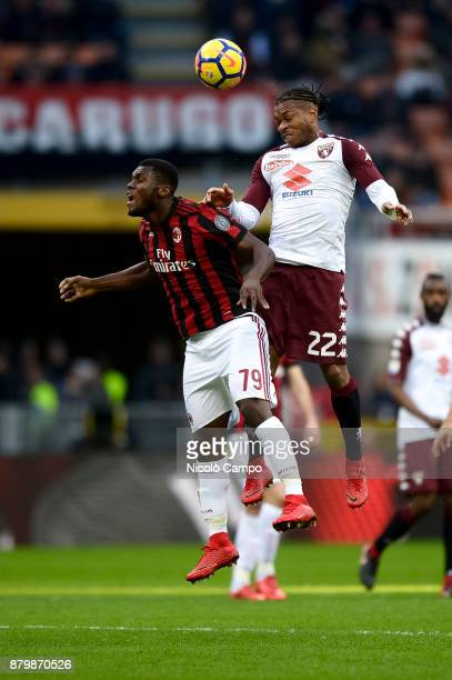 Joel Obi of Torino FC competes for a header with Franck Kessie of AC Milan during the Serie A football match between AC Milan and Torino FC The match...
