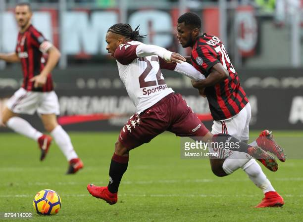 Joel Obi of Torino FC competes for the ball with Franck Kessie of AC Milan during the Serie A match between AC Milan and Torino FC at Stadio Giuseppe...