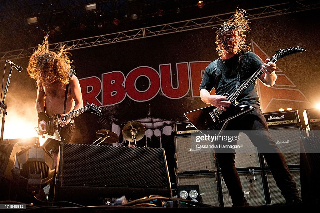 Joel O'Keeffe & David Roads of Airbourne perform for fans on day 3 of the 2013 Splendour In The Grass Festival on July 28, 2013 in Byron Bay, Australia.