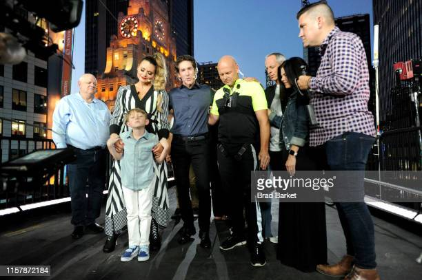 Joel Osteen prays with Lijana Wallenda Nik Wallenda and the Wallenda family before Highwire Live In Times Square With Nik Wallenda on June 23 2019 in...