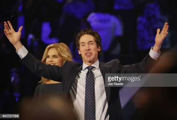 Joel Osteen the pastor of Lakewood Church stands with his wife Victoria Osteen as he conducts a service at his church as the city starts the process...