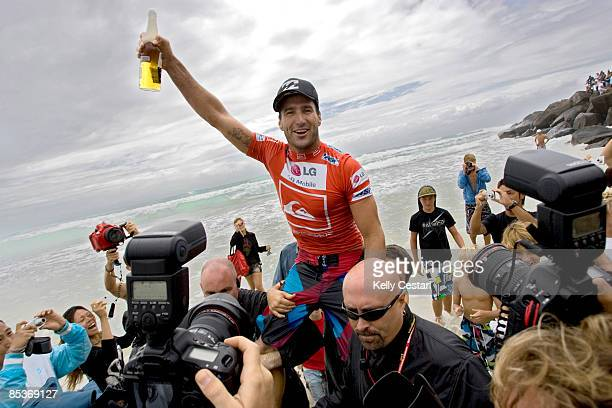 Joel Parkinson of Australia is carried up the beach after winning the Quiksilver Pro Gold Coast presented by LG Mobile on March 11, 2009 on the Gold...