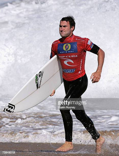 Joel Parkinson of Australia runs up the beach after competing in round three of the Rip Curl Pro on April 10 2007 at Johanna Beach Australia