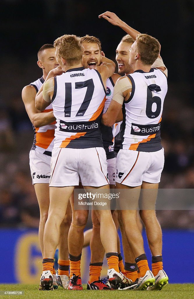 Joel Patfull of the Giants celebrates a goal with teamates during the round seven AFL match between the Carlton Blues and the Greater Western Sydney Giants at Etihad Stadium on May 16, 2015 in Melbourne, Australia.