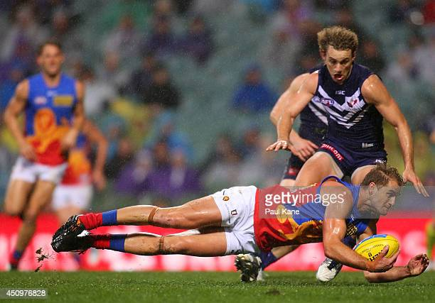 Joel Patfull of the Lions marks the ball during the round 14 AFL match between the Fremantle Dockers and the Brisbane Lions at Patersons Stadium on...