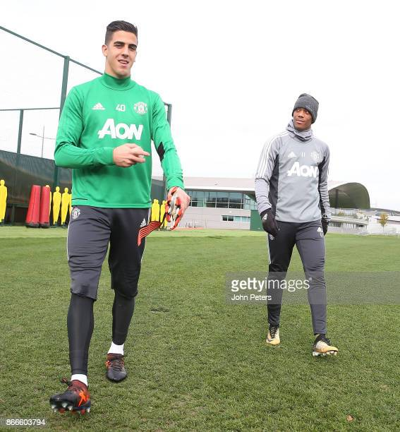 Joel Pereira and Anthony Martial of Manchester United in action during a first team training session at Aon Training Complex on October 26 2017 in...