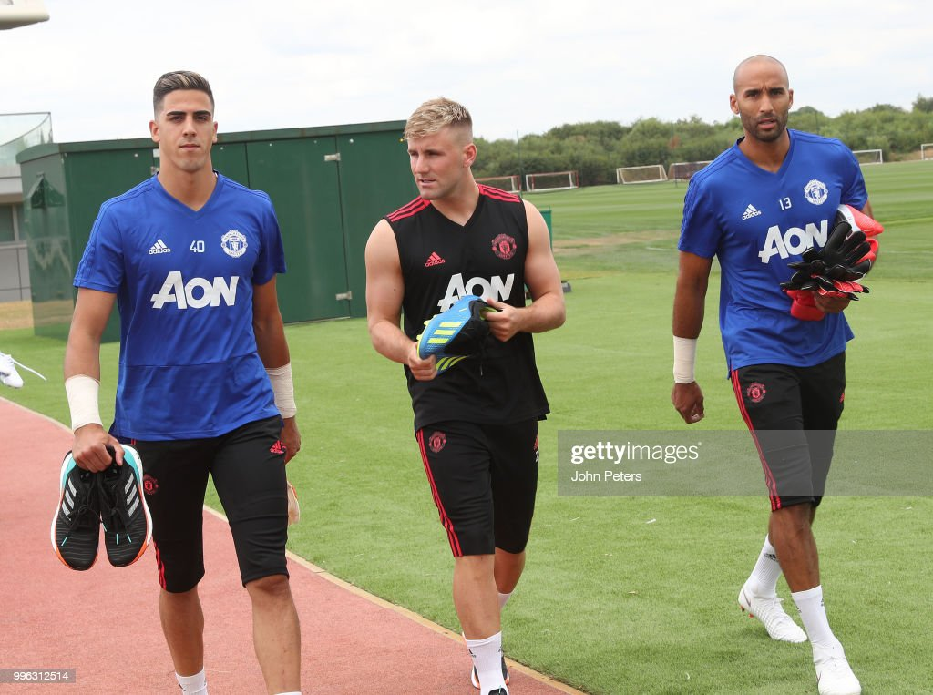 Joel Pereira and Luke Shaw of Manchester United walk out ahead of a first team training session at Aon Training Complex on July 11, 2018 in Manchester, England.