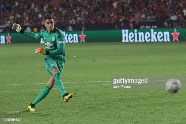 Joel Pereira of Manchester United takes a penalty during a penalty shootout during the preseason friendly match between Manchester United and AC...