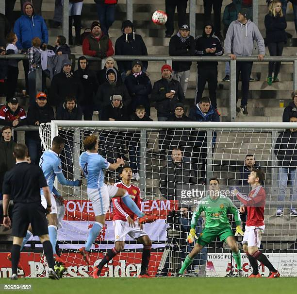 Joel Pereira of Manchester United U21s in action with Kean Bryan of Manchester City U21s during the U21 Premier League match between Manchester...