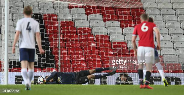 Joel Pereira of Manchester United U23s saves a penalty from Kazaiah Sterling of Tottenham Hotspur U23s during the Premier League 2 match between...
