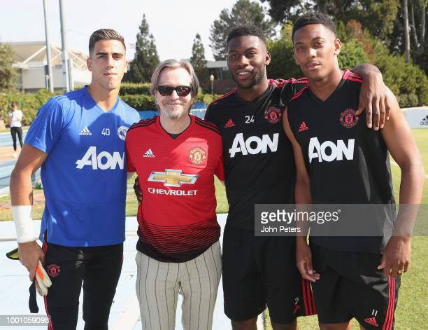Joel Pereira Timothy FosuMensah and Anthony Martial of Manchester United pose with actor Gary Oldman after a first team training session as part of...