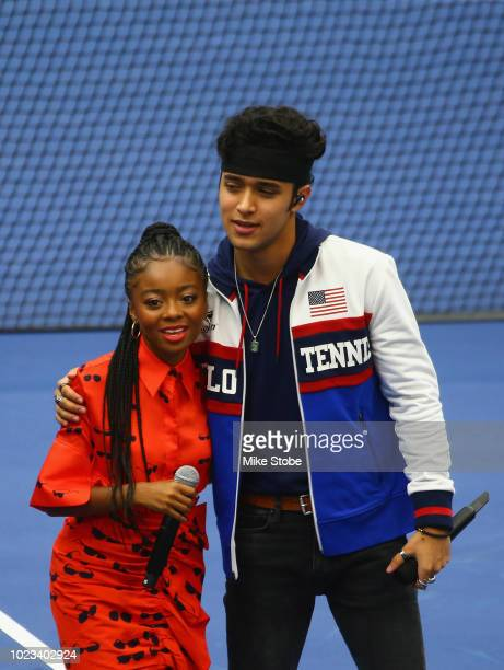 Joel Pimentel of band CNCO and actress/host Skai Jackson are seen during the stadium show for Arthur Ashe Kids' Day prior to the start of the 2018 US...