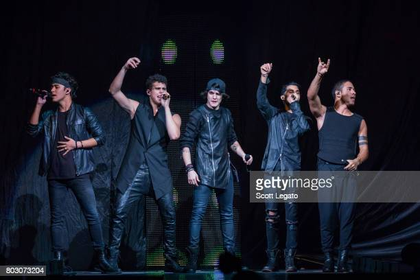 Joel Pimentel Zabdiel De Jesus Christopher Velez Erick Brian Colon and Richard Camacho of CNCO performs at The Palace of Auburn Hills on June 28 2017...