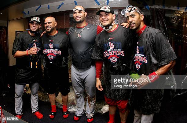 Joel Pineiro Jose Oquendo Albert Pujols Yadier Molina and Julio Lugo of the St Louis Cardinals pose for a photo as they celebrate in the clubhouse...