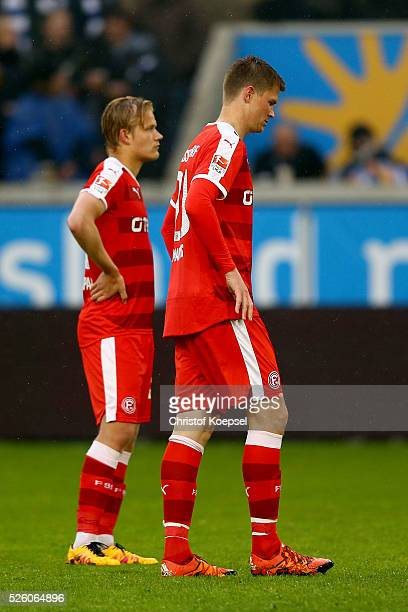Joel Pohjanpalo and Alexander Madlung of Duesseldorf look dejected during the 2. Bundesliga match between MSV Duisburg and Fortuna Duesseldorf at...
