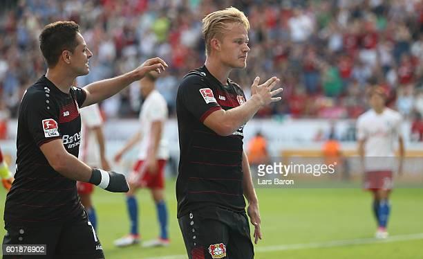 Joel Pohjanpalo celebrates after scoring his teams first goal during the Bundesliga match between Bayer 04 Leverkusen and Hamburger SV at BayArena on...