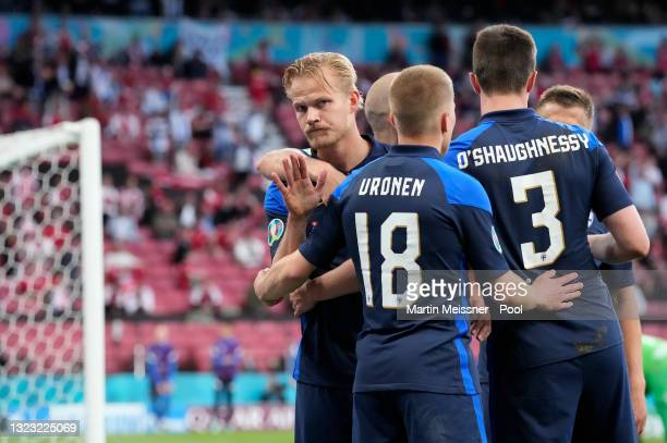 Joel Pohjanpalo of Finland celebrates with team mates after scoring their side's first goal during the UEFA Euro 2020 Championship Group B match...