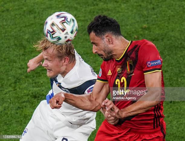 Joel Pohjanpalo of Finland in action against Nacer Chadli of Belgium during the EURO 2020 Group B third match between Finland and Belgium at Saint...