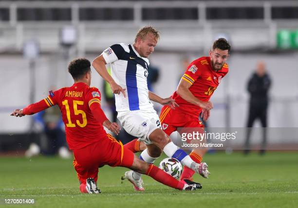 Joel Pohjanpalo of Finland is challenged by Ethan Ampadu of Wales and Tom Lockyer of Wales during the UEFA Nations League group stage match between...