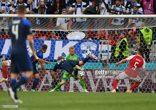 Joel Pohjanpalo of Finland scores their side's first goal past Kasper Schmeichel of Denmark during the UEFA Euro 2020 Championship Group B match...