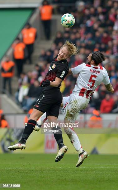 Joel Pohjanpalo of Leverkusen and Dominic Maroh of Koeln battle for the ball during the Bundesliga match between 1 FC Koeln and Bayer 04 Leverkusen...