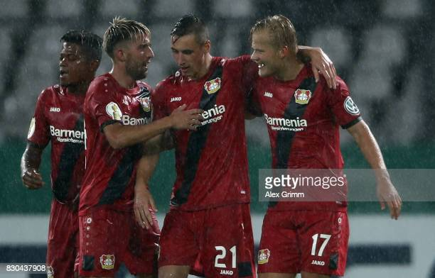 Joel Pohjanpalo of Leverkusen celebrates his team's second goal with team mates during the DFB Cup first round match between Karlsruher SC and Bayer...