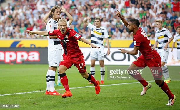 Joel Pohjanpalo of Leverkusen celebrates scoring the 10 goal with Karim Bellarabi of Leverkusen during the Bundesliga match between Borussia...