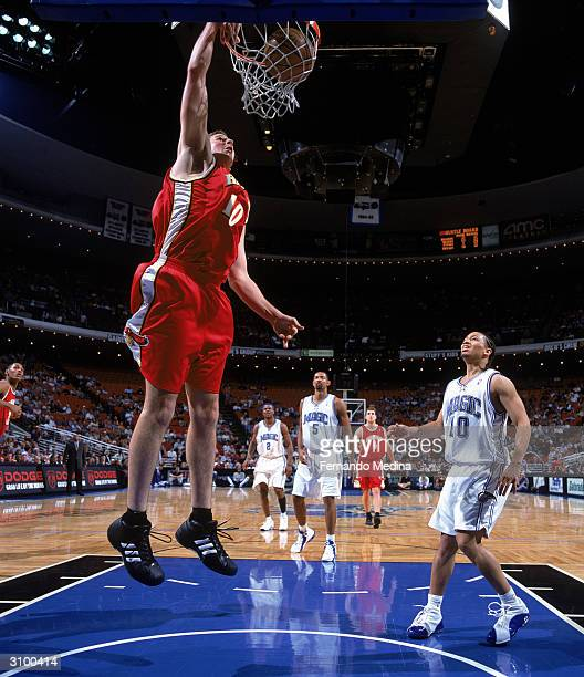 Joel Przybilla of the Atlanta Hawks dunks during the game against the Orlando Magic at TD Waterhouse Centre on March 5 2004 in Orlando Florida The...
