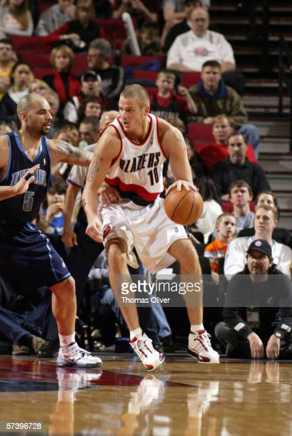 Joel Przybilla of the Portland Trail Blazers posts up against Carlos Boozer of the Utah Jazz on April 1, 2006 at the Rose Garden in Portland, Oregon....