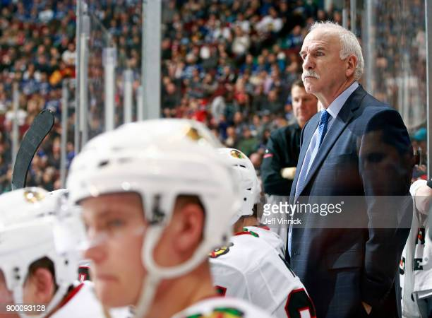 Joel Quenneville of the Chicago Blackhawks looks on from the bench during their NHL game against the Vancouver Canucks at Rogers Arena December 28...