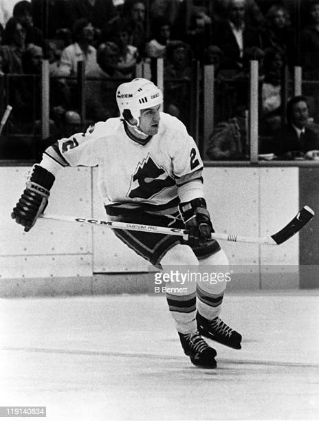 Joel Quenneville of the Colorado Rockies skates on the ice during an NHL game during the 1980 season at the McNichols Sports Arena in Denver Colorado
