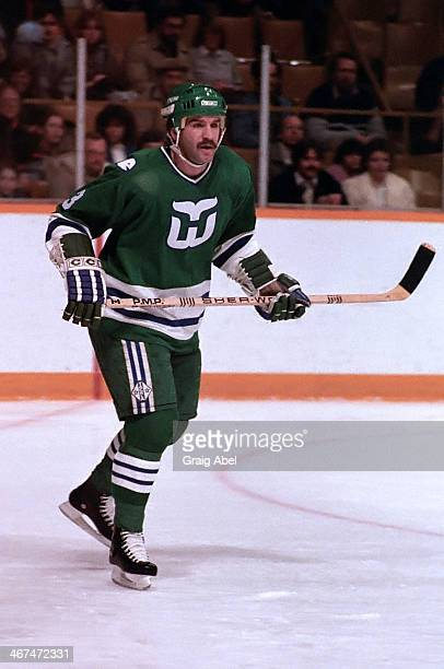 Joel Quennville of the Hartford Whalers watches the play against the Toronto Maple Leafs on January 7 1985 at Maple Leaf Gardens in Toronto Ontario...