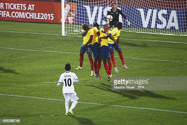 Joel Quintero of Ecuador blocks a free kick by Jafeth Leiva of Honduras during the FIFA U17 Men's World Cup Chile 2015 group D match between Honduras...